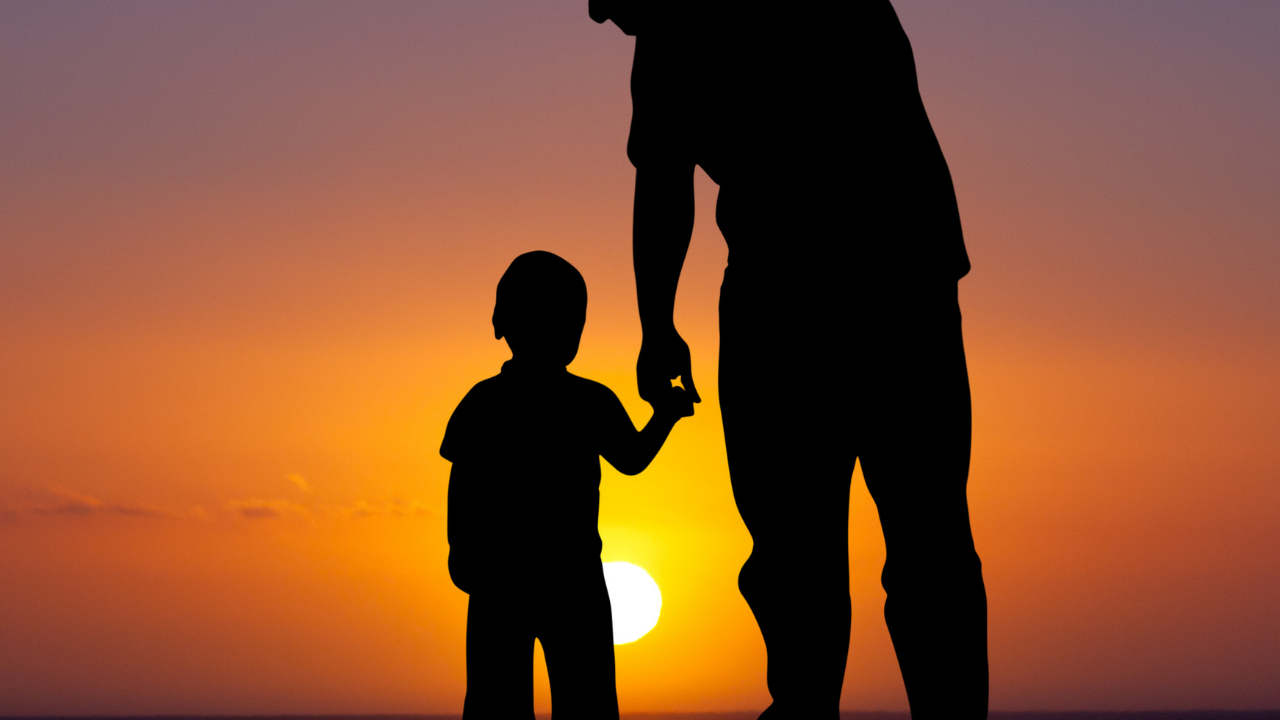 Father and son watch the sunset
