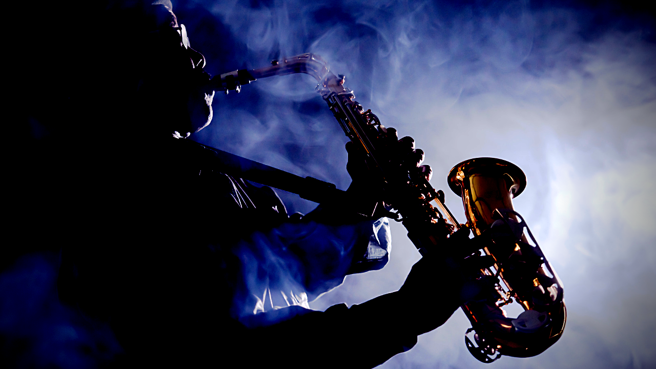 A saxophonist plays the alto sax