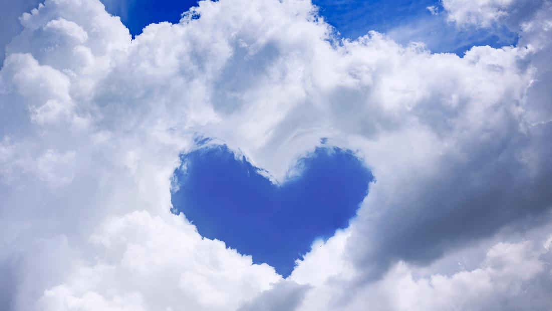 A picture of a blue sky with white clouds, and the clouds are positioned such to create the outline of heart. It's really quite beautiful, I wish you could see it.