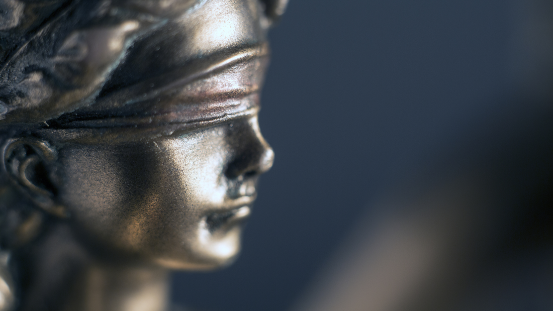 A close up of Lady Justice wearing a blindfold.